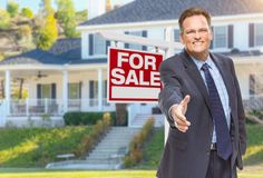 Male Agent Reaching for Hand Shake in Front of House and For Sal Stock Photos