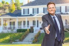 Male Agent Reaching for Hand Shake in Front of House Stock Photography