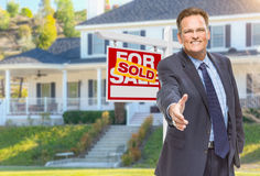 Male Agent Reaching for Hand Shake in Front of House and Sold Re Royalty Free Stock Photos