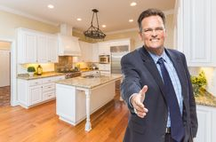 Male Agent Reaching for Hand Shake in New Kitchen Royalty Free Stock Images