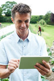 Male Agricultural Worker Using Digital Tablet In Field Stock Image
