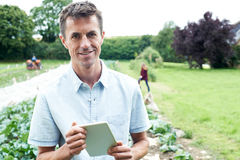 Male Agricultural Worker Using Digital Tablet In Field Stock Photography