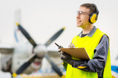 Male airport worker. Runway control happy maintenance Royalty Free Stock Images