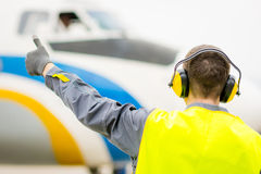 Male airport worker. Thumb up success maintenance Royalty Free Stock Photos