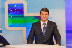 Male anchorman in tv studio. Live broadcasting Royalty Free Stock Photography
