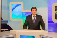 Male anchorman in tv studio. Live broadcasting Stock Photo