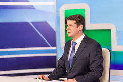 Male anchorman in tv studio. Live broadcasting Stock Images