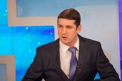 Male anchorman in tv studio. Live broadcasting Stock Image