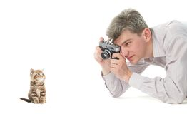 Animal photographer taking photo of kitten Royalty Free Stock Photography
