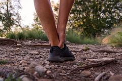 Male ankle injury during jogging stock photos