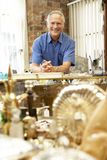 Male antique shop proprietor Royalty Free Stock Image