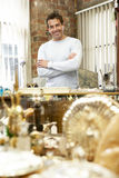 Male antique shop proprietor Royalty Free Stock Photos