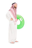 Male arab person holding a swimming ring Stock Images