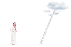 Male arab person standing in front of a ladder stock photos