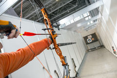 Male archer shooting in competitions of the compound bow with arrows Stock Photo