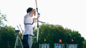 Male archer training on a range with targets. 4K stock footage