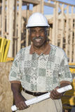 Male Architect With Blueprint At Construction Site Royalty Free Stock Image