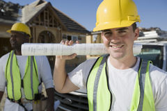 Male Architect With Blueprint At Site Stock Photography