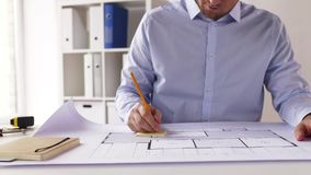 Male architect with blueprint taking notes stock video
