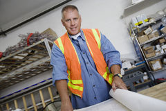 Male Architect With Blueprint At Workplace Royalty Free Stock Photography