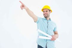 Male architect with blueprints pointing away Royalty Free Stock Photo
