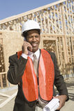 Male Architect On Call With Blueprint Royalty Free Stock Image
