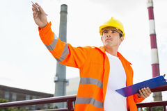 Male architect with clipboard at industry Royalty Free Stock Photo
