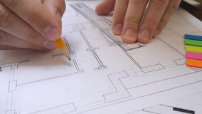 Male Architect Hand Drafting Project of Apartment