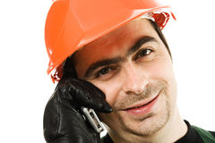 Male architect in a hardhat. Talks by a mobile phone on a white background Stock Photography
