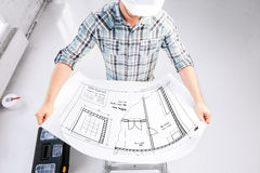 Male architect in helmet with blueprint Stock Photos