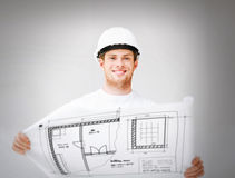 Male architect in helmet with blueprint Stock Image