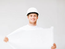 Male architect in helmet with blueprint Royalty Free Stock Image