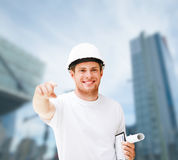 Male architect in helmet pointing at you Royalty Free Stock Images