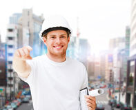 Male architect in helmet pointing at you Royalty Free Stock Photography