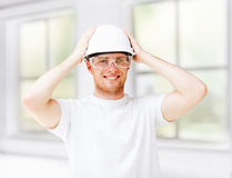 Male architect in helmet with safety glasses. Architecture concept - male architect in helmet with safety glasses Stock Photography