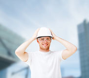 Male architect in helmet with safety glasses. Building, developing, consrtuction and architecture concept - picture of male architect in white helmet with safety Stock Photos
