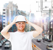 Male architect in helmet with safety glasses. Building, developing, construction and architecture concept - male architect in helmet with safety glasses Stock Images