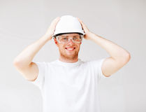 Male architect in helmet with safety glasses. Picture of male architect in helmet with safety glasses Stock Photography