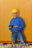 Male Architect Holding Digital Tablet Against Trailer Stock Image