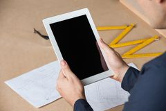 Male Architect Holding Digital Tablet At Table Royalty Free Stock Images