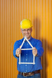 Male Architect Holding House Frame Against Trailer Royalty Free Stock Images