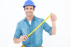 Male architect holding tape measure. Portrait of male architect holding tape measure over white background Stock Photos