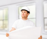 Male architect looking at blueprint at home Royalty Free Stock Photography