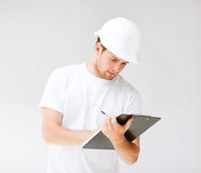Male architect looking at blueprint Royalty Free Stock Photography