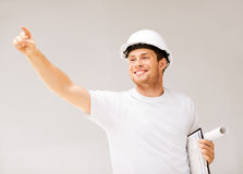 Male architect looking at blueprint Stock Images