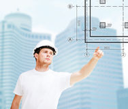 Male architect pointing at blueprint Stock Photography