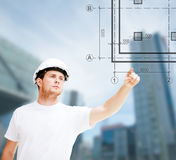 Male architect pointing at blueprint Royalty Free Stock Photo