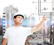 Male architect pointing to blueprint Royalty Free Stock Photo