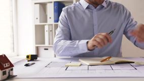 Male architect with ruler measuring blueprint stock footage