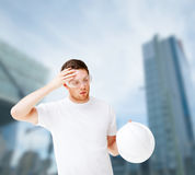 Male architect in safety glasses taking off helmet Stock Photography